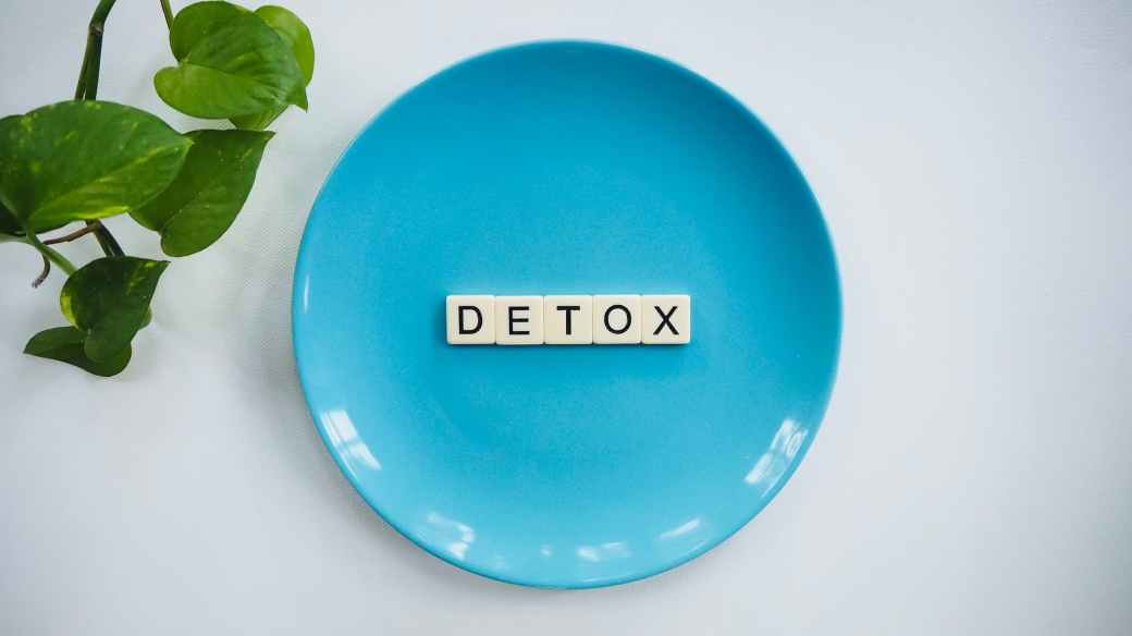 detox text on round blue plate